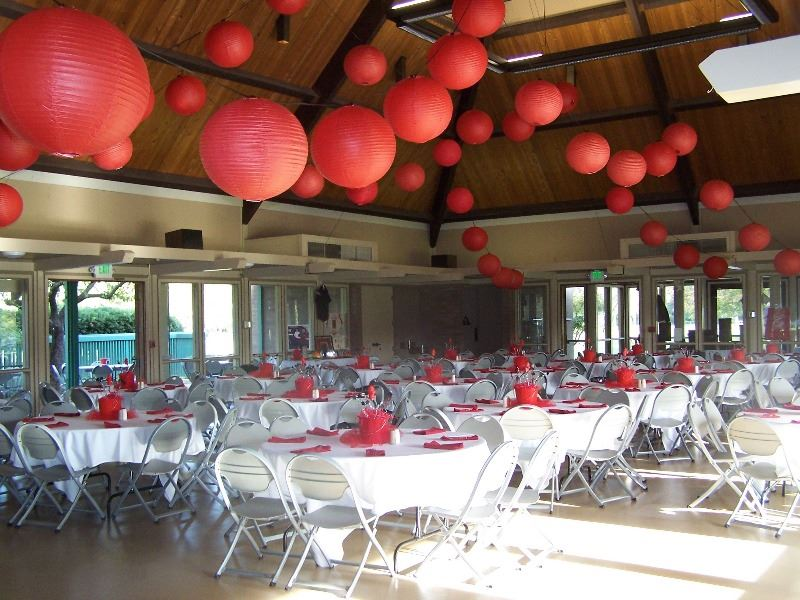 The reception hall is decorated in flowers and large balloons for a wedding