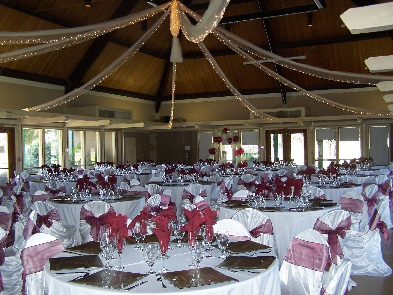 The reception hall is decorated in flowers and streamers for a wedding