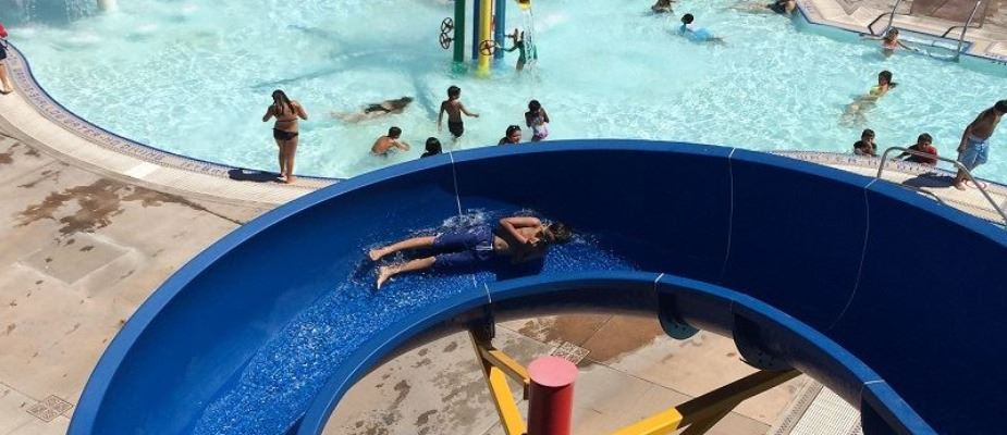 Child sliding down Typhoon Tower slide