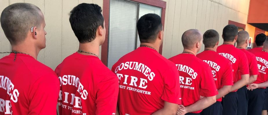 Fire recruits are lined up in their fire shirts