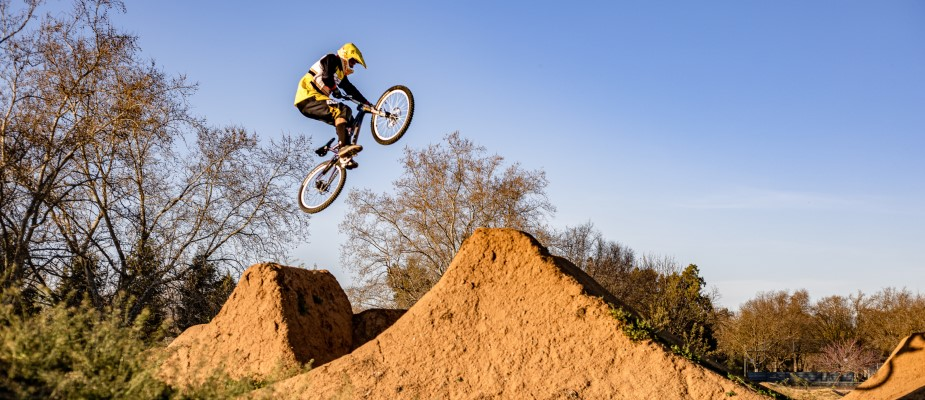 Bike Park Participant catching air off of a jump