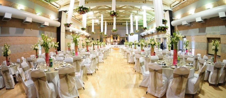 Flowers and fabric decorate the room for a wedding