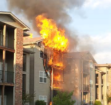 A fire consumes an apartment building.