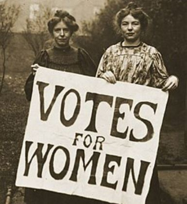 Female suffragettes holding sign