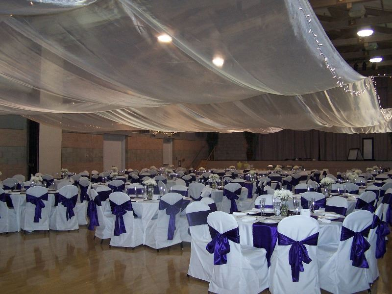 The reception hall is decorated in flowers and bows for a wedding