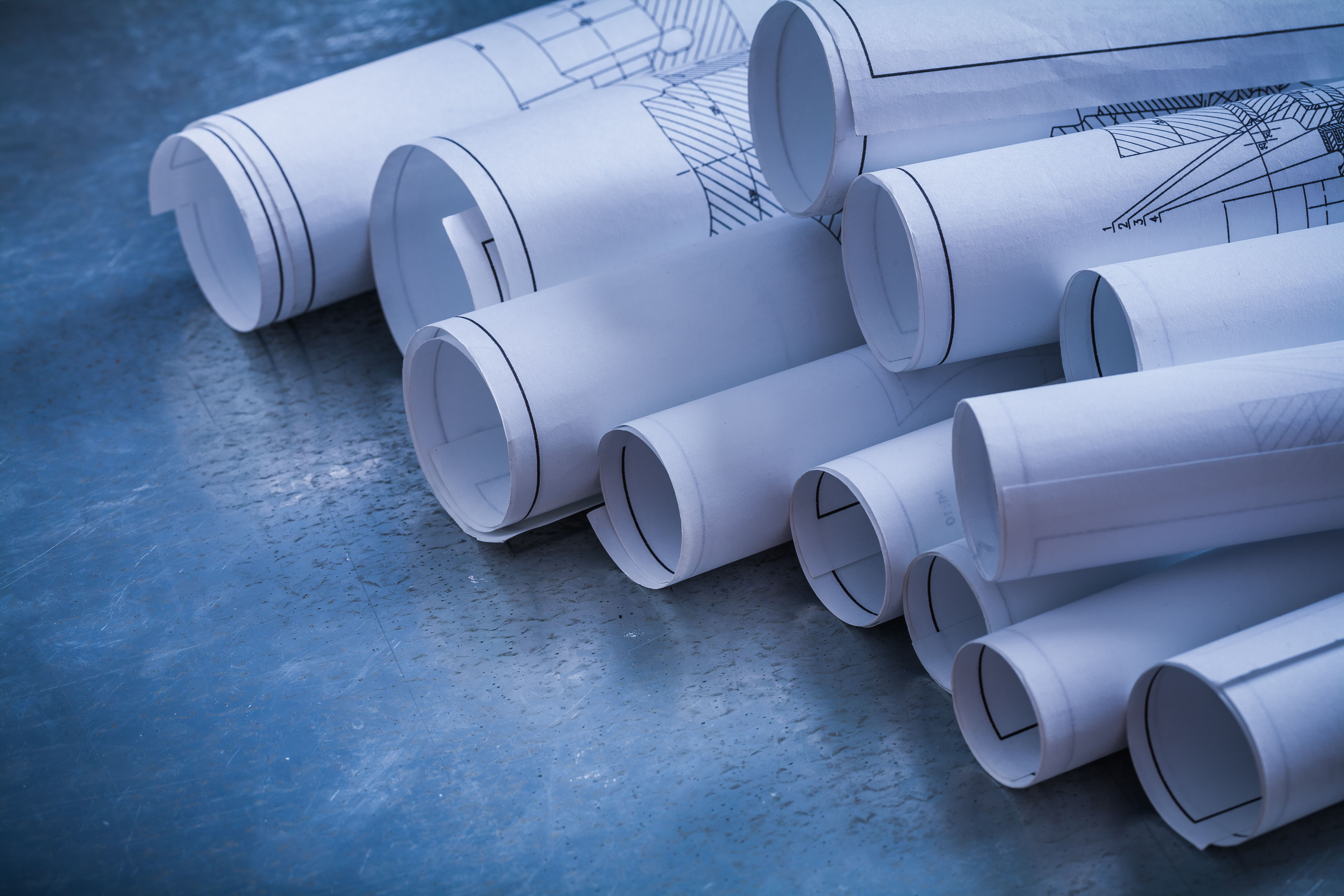 Rolls of blueprints.