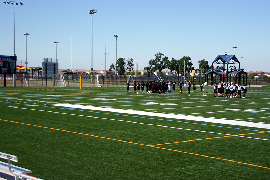 A team gathers for flag football at Bartholomew Sports Park