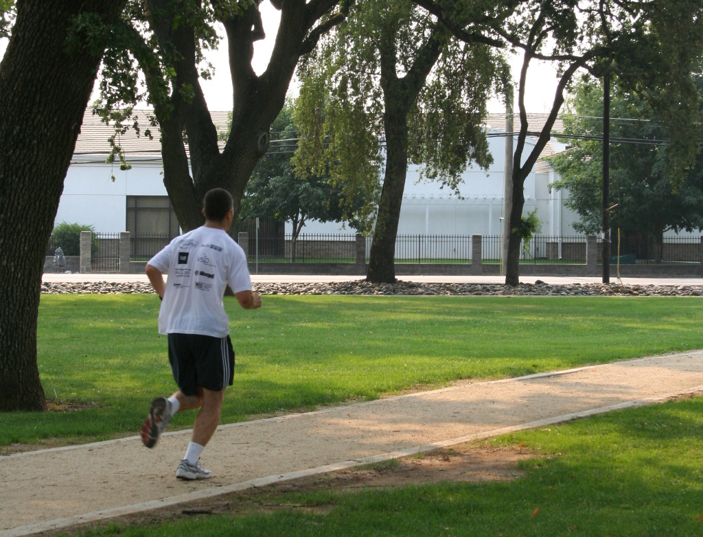A man jogs on the Elk Grove Multi Use Trail